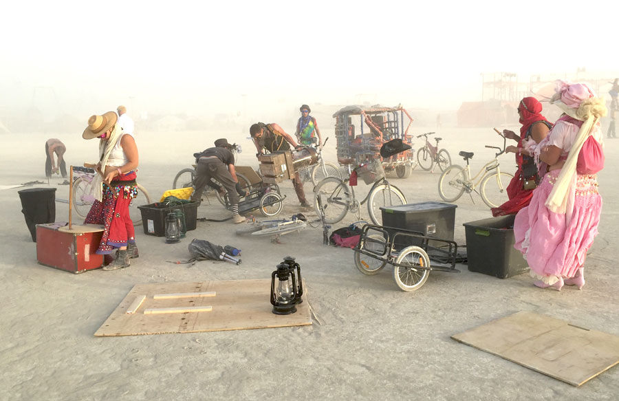 Our performance troupe unloading and preparing to build our stage during a dust storm.
